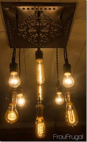 bare edison bulb chandelier with lights on