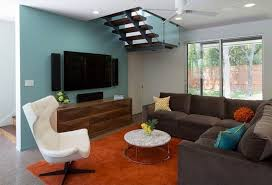 wall paint for brown furniture. blue wall paint and living room furniture in dark brown color for a