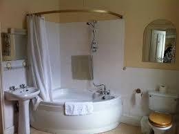 shower over corner bath. corner tub shower - like the idea of new head no pipes to run over bath b