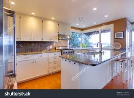 Oak Floors In Kitchen Luxury White Kitchen Oak Floors And Beautiful Granite Stock Photo