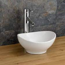 counter mounted oval small cloakroom sink