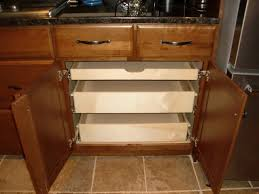 Pull Out Shelves In A Kitchen Cabinet Kitchen Drawer Organizers