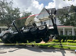 this photo released by the orlando fire department shows a truck carrying a crane tipped over