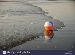 beach ball on beach. Beach Ball On Ocean Shorline