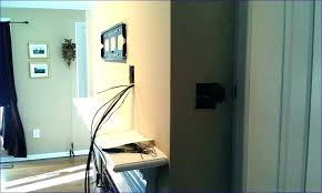 hide speaker wire on wall hide wires on floor behind hiding above brick fireplace speaker wire hide speaker wire on wall