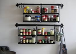 Unique Spice Rack Designed by Colin McMillen Showing Black Accent on Grey  Wall