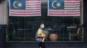 A boy and his father wait to. Malaysia Covid Stocks Trade Lower As Country For Total Lockdown