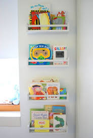 love this idea for a mini library in a child s room with these shallow wooden shelves