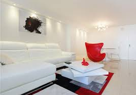 modern living room with limestone tile flooring and bright red accent pieces