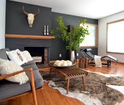 brick fireplace mantel living room contemporary with animal skull black wall image by donna dufresne interior design