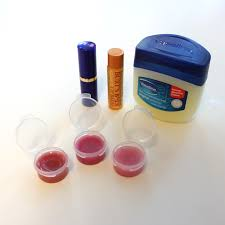 make your own lip gloss you need chap stick lipstick or eyeshadow vaseline and littl containers to hold your lip gloss in