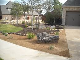 Front yard landscape - Xeriscape theme with decomposed granite, mulch, a  dry creek bed