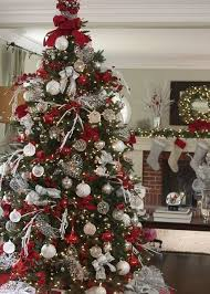 Tree toppers are a must for an elegant display. Silver Stretch Net ribbon  and loops