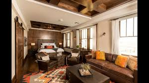 the tack room in the pioneer woman boarding house has wood floors cowhide rugs and paneled walls