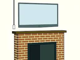 wall mount flat screen television mounting above fireplace hiding wires how to hide wires on wall