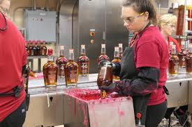 the first bottle was dipped using wax heated up in a deep fryer on the samuels stove the formula for maker s mark s wax used today was developed by tom