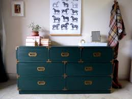 No I didn't repaint the muted teal dresser. I actually found an almost  identical 7 drawer dresser.