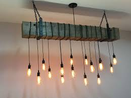a custom reclaimed barn beam chandelier light fixture modern rustic restaurant bar lighting made to order from 7m woodworking