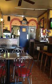 juarez mexican restaurant warm decor yellow walls and tiled floors