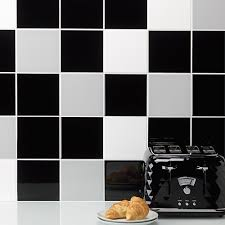 keep your look simple and costs down by choosing plain square tiles then add interest by combinging black white and grey designs for a smart finish