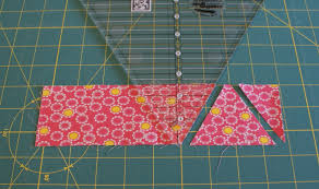andie johnson sews: How to Use a 60-degree Quilting Ruler - Tutorial & Flip the ruler 180-degrees so it's pointing the opposite direction of your  first cut. Cut next triangle. Adamdwight.com