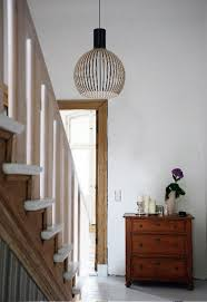 secto design lighting. the black secto design light hung in a hallway creating sense of space lighting