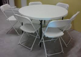 48 round table and 6 white plastic chairs pkg