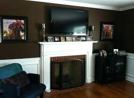hanging a tv above a gas fireplace living room with above gas fireplace we mounted the