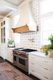 laminate backsplash kitchen tiles rustic farmhouse urban marble countertops gold hardware cast iron stove ideas