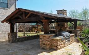 outdoor kitchens in the woodlands hortus landscape design rustic covered kitchen outdoor kitchens and bars