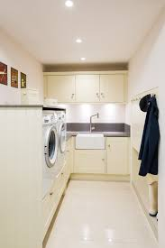 lisa melvin design was asked to squeeze plenty of storage and a large belfast style sink into this compact space the appliances were elevated for ease of