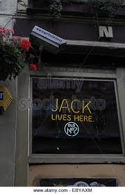 jack daniels portrait stock photos jack daniels portrait stock portrait yellow neon jack lives here old no 7 jack daniel s advert glass window