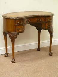reion mahogany kidney shaped desk tooled inset leather top fitted with five drawers
