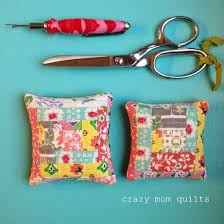 crazy mom quilts: finish it up Friday & I made a pair of pincushions (for gifts) using the tiniest of feed sack  scraps. No fabric, especially feed sacks, should go to waste!!! Adamdwight.com