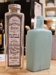 thrifty bottle makeovers decoupage chalk paint label applied and first coat of