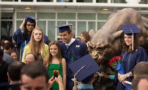 discover florida international university fiu graduates gather around the fiu panther statue