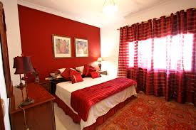 fancy red bedroom with striped curtains for everlasting look