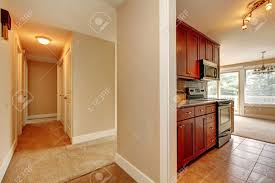 Empty Kitchen Wall Empty Hallway With Carpet Floor And Ivory Walls View Of Kitchen