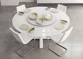 white modern round dining table