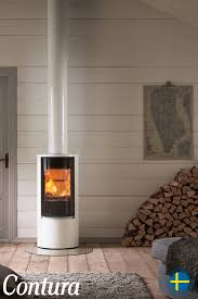Choose the Contura 510 Style stove if you want to position your stove in a  corner. The large glass door spreads the light and heat around the room.