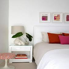 bedroom with white walls and pops of colors