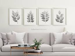 prints above sofa wall decor black