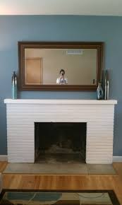 breathtaking white painted fireplace mantel also square wall mounted mirror frames in traditional living areas designs