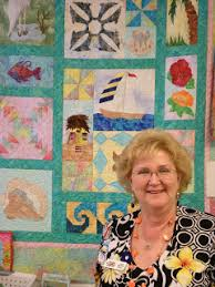 Quilt Shops: Quilt Shop of DeLand - DeLand, FL & Meet Judy Hansen, shop owner and quilt designer. Judy is pictured here  (above and below) with two of the quilts she's designed. Adamdwight.com