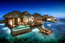 Sandals Royal Caribbean: Overwater Bungalow - Night View. Photo Credit:  Sandals Resorts