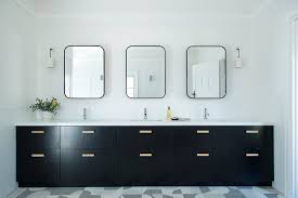 In this kids bathroom we created a generous vanity with deep drawers, and  individual mirrored cabinets above. To the side, I also built out part of  the wall ...