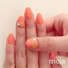 5月に発売予定のthree新色オレンジをイメージ オールマットコート