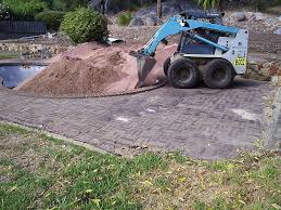 bobcat working filling swimming pool in a o61