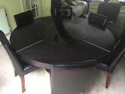 large round black oak dining table with led lights and lazy susan plus 6 chairs