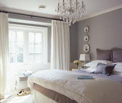 crystal chandelier over a bed